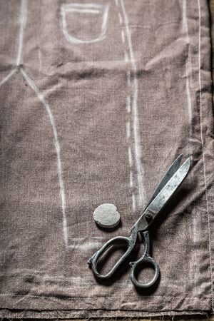 Tailor draft trousers on the material in tailoring workshop