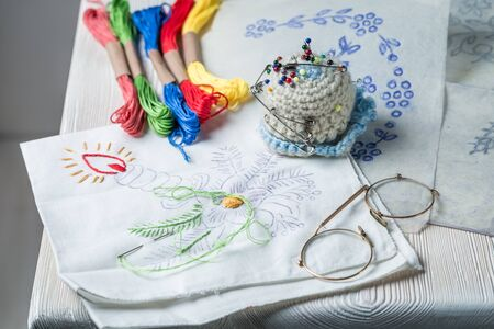 Embroidered napkins with color mulina on rustic table