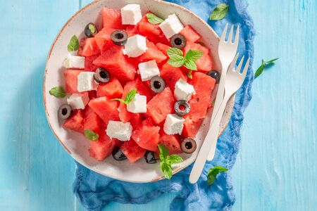 Tasty watermelon salad with feta, olives and mint