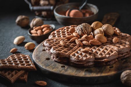 Closeup of homemade waffles with dark chocolate and nuts 스톡 콘텐츠