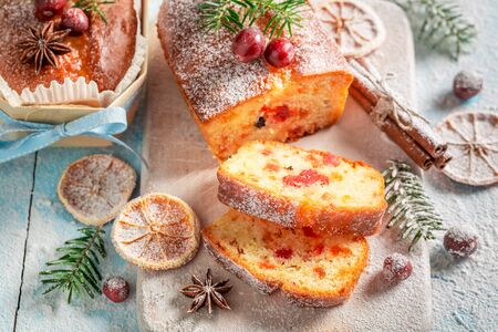 Tasty Fruitcake for Christmas baked in a wooden mold