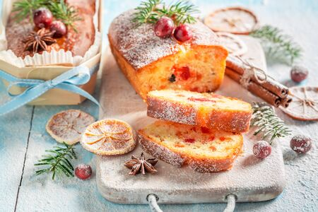 Homemade Fruitcake for Christmas decorated with spruce Standard-Bild