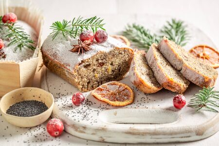 Homemade poppy seed cake for Christmas with orange and cranberry