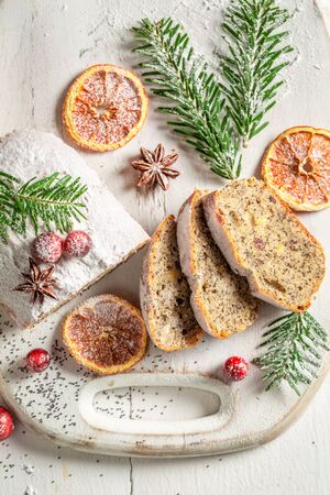 Delicious poppy seed cake for Christmas with orange and cranberry