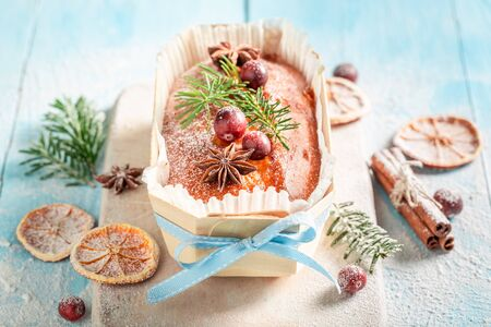 Delicious Fruitcake for Christmas baked in a wooden mold Standard-Bild