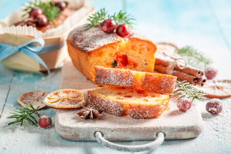 Traditionally Fruitcake for Christmas baked in a wooden mold Standard-Bild