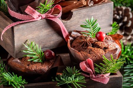 Homemade gingerbread muffins for Christmas decorated with spruce Stock Photo - 129305707