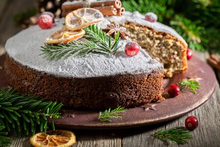Homemade poppy seed cake for Christmas with orange and spruce