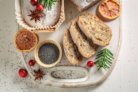 Traditionally poppy seed cake for Christmas decorated with spruce