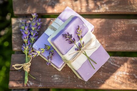 Healthy and natural lavender soap in summer garden