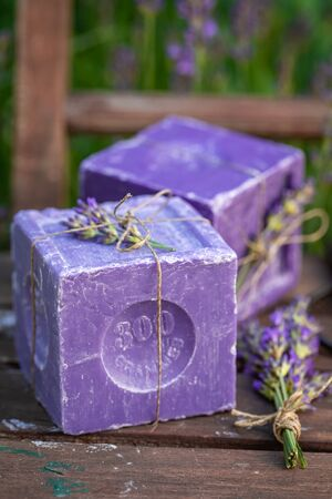 Moisture and natural lavender soap in summer garden Stock Photo