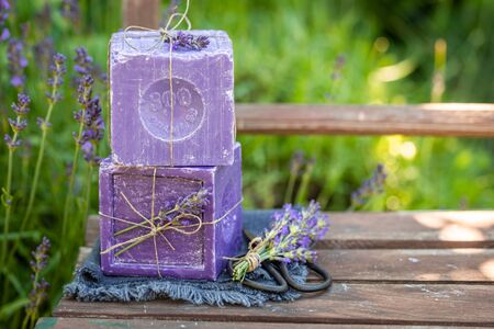 Healthy and natural lavender soap on an old wooden chair Stock Photo