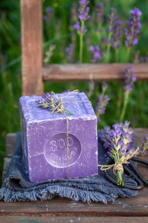 Aromatic and ecological lavender soap on an old wooden chair 版權商用圖片