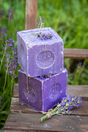 Healthy and natural lavender soap in sunny garden