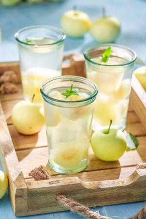 Closeup of tasty apple juice with apples and mint Reklamní fotografie - 130116010