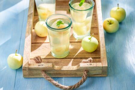 Delicious and homemade apple juice made of fresh fruits Reklamní fotografie - 130116016
