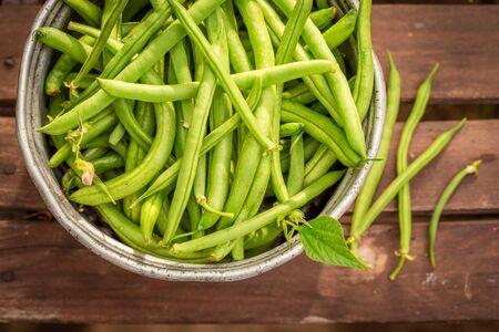 Fresh and raw green beans in an old aluminum pot Reklamní fotografie
