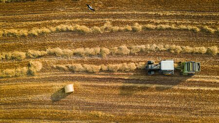 Machines for collecting and pressing hay, aerial view 写真素材