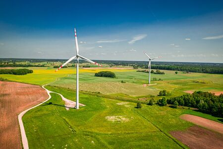 Wind turbines on green field in Poland, Poland from above Reklamní fotografie