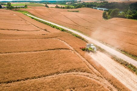 Big harvester working on field in Poland, aerial view