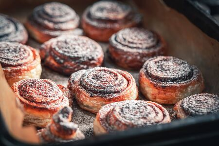 Tasty cinnamon rolls made of spices and puff pastry