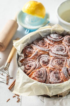 Freshly baked cinnamon rolls with spices, cocoa and sugar