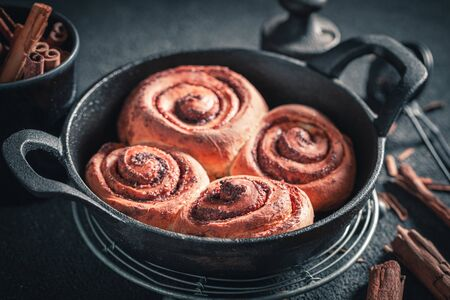 Tasty cinnamon buns as swedish christmas dessert. Stock fotó - 130798920