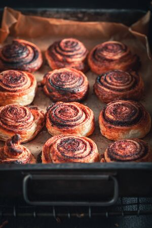 Sweet cinnamon rolls made of puff pastry and cocoa