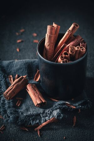 Closeup of aromatic cinnamon sticks as rustic background