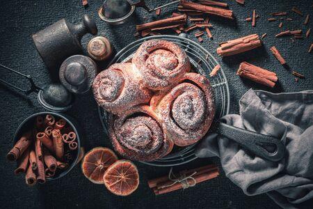 Enjoy your cinnamon rolls as swedish christmas dessert. Reklamní fotografie