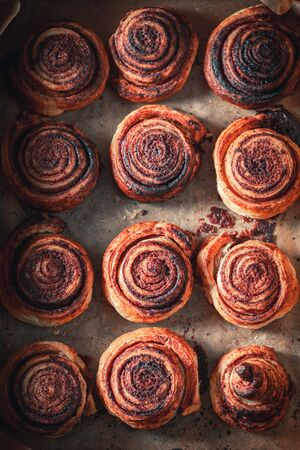 Traditionally cinnamon rolls made of puff pastry and cocoa Stock fotó