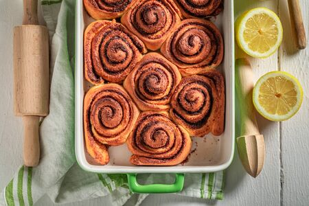 Tasty cinnamon buns with spices, cocoa and sugar