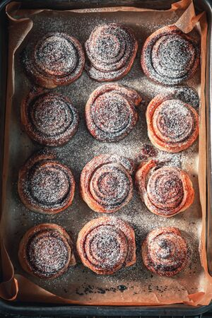 Freshly baked cinnamon rolls made of puff pastry and cocoa Stock fotó