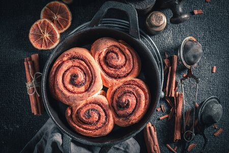 Freshly baked cinnamon rolls made of butter and sugar