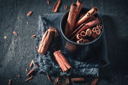 Aromatic cinnamon sticks in a dark mug