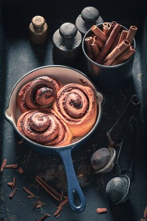 Enjoy your cinnamon buns with spices, cocoa and sugar
