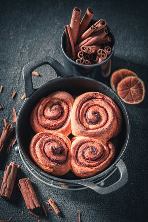 Delicious cinnamon rolls with spices, cocoa and sugar