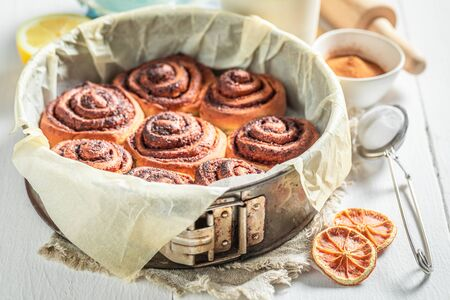 Homemade cinnamon rolls with spices, cocoa and sugar