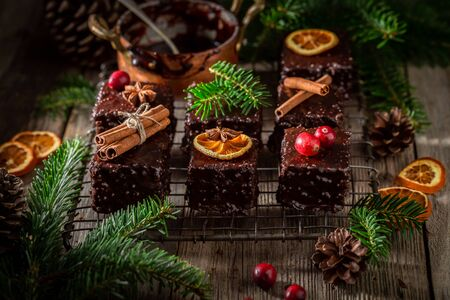 Traditionally and sweet Gingerbread cubes for Christmas with ingredients