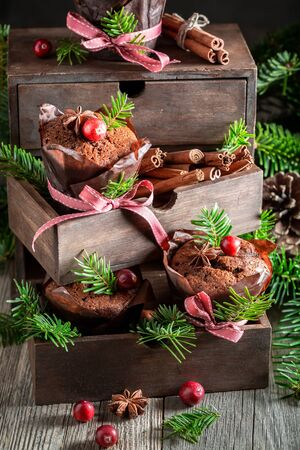 Gingerbread muffins for Christmas with cranberry and ribbon