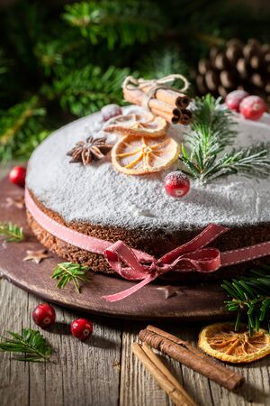 Tasty poppy seed cake for Christmas on rustic plate