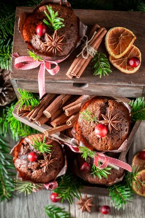 Closeup of Gingerbread muffins for Christmas with cranberry and ribbon