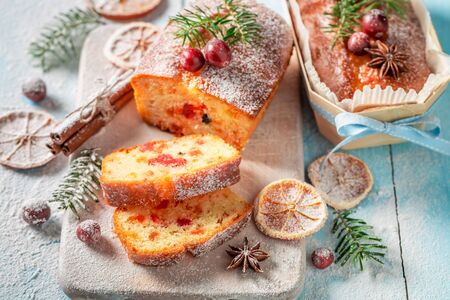 Traditionally Fruitcake for Christmas decorated with sugar powder