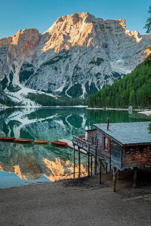 Sunrise at Lago di Braies and wooden hut, Dolomites Stok Fotoğraf