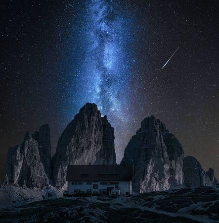 Stunning milky way over Dreizinnen hut in Tre Cime, Dolomites Stock Photo
