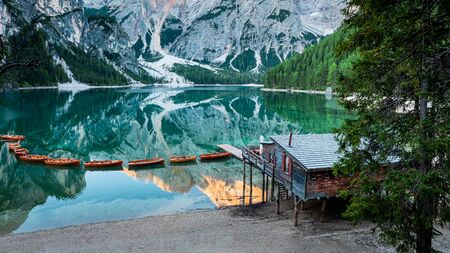 Stunning wooden hut and Lago di Braies in Dolomites, Italy