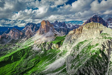 Averau peak in Dolomites and green hills, aerial view, Italy