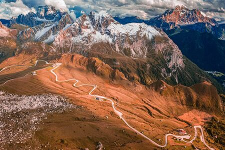 Serpentine in Passo Giau, Dolomites in autumn, Aerial view Stock Photo