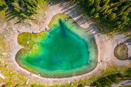 Top view of Carezza lake in Dolomites, Italy