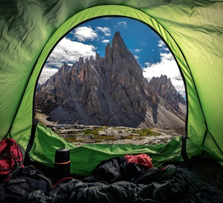 Camping in tent at Tre Cime in Dolomites, Italy Stock Photo